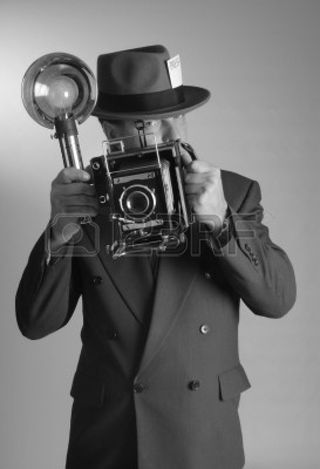 9519849-1940-s-style-photojournalist-in-portrait-aspect-ratio